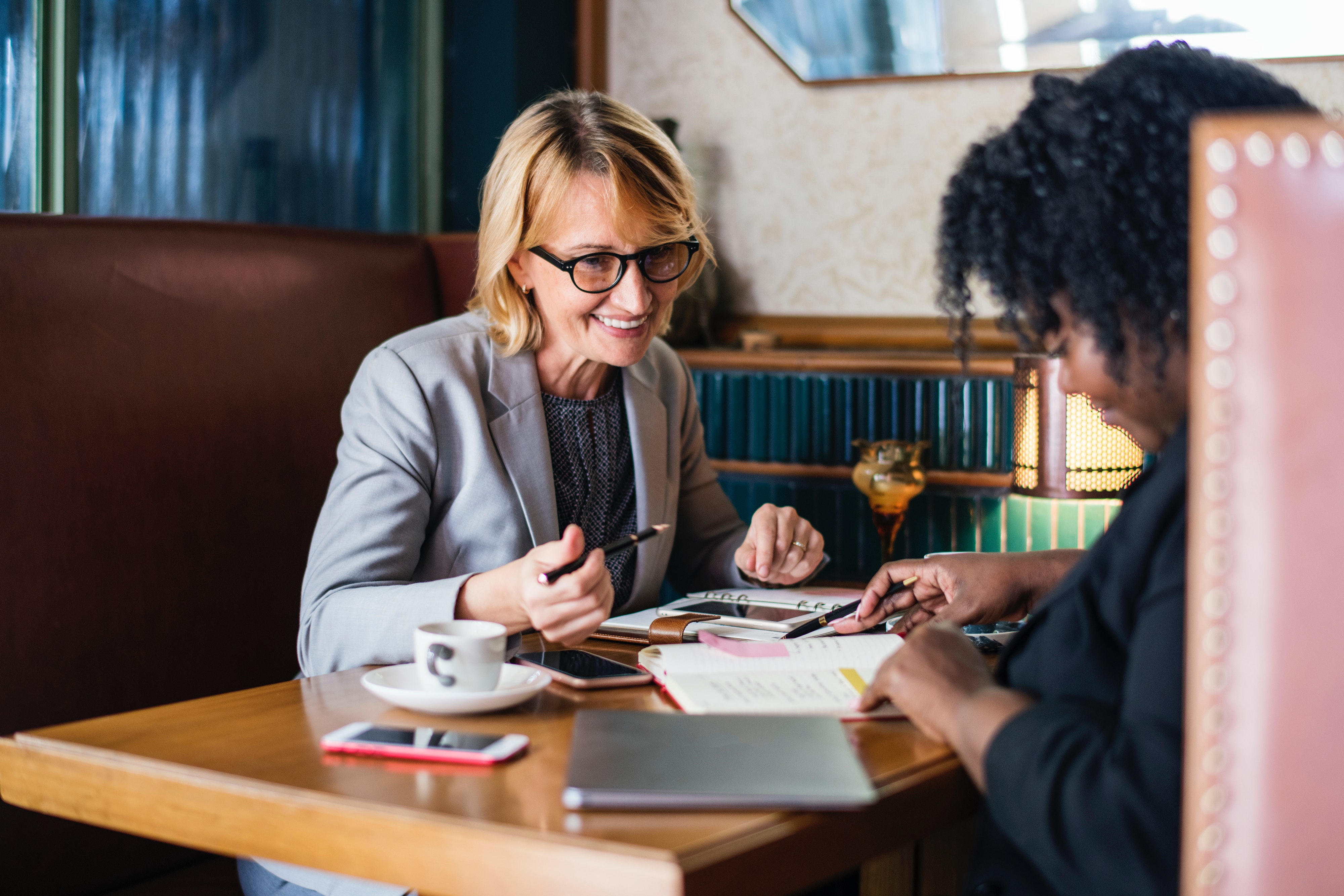 Request a Consultation - Smiling Women Discussion | Legal Consulting Firm